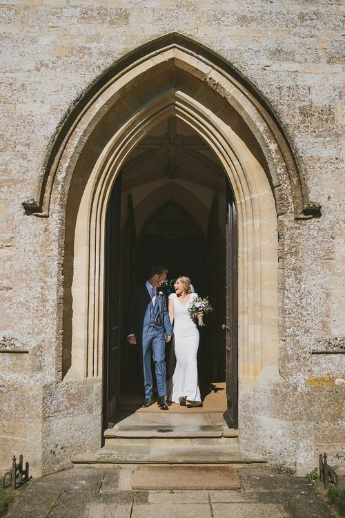 Bride in Pronovias Irune Gown & Groom in Hugo Boss Suit