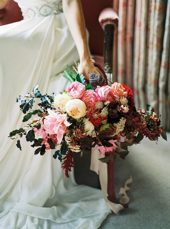 Red & Pink Bouquet by Martha & the Meadow | Opulent Wedding Inspiration at Warmwell House in Dorset with Rich colour Palette Planned by Kelly Chandler | Imogen Xiana Photography | Gorgeous Films