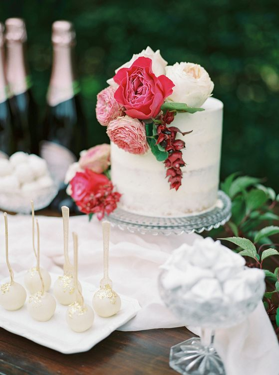Iced Wedding Cake with Floral Decor by France Buns | Opulent Wedding Inspiration at Warmwell House in Dorset with Rich colour Palette Planned by Kelly Chandler | Imogen Xiana Photography | Gorgeous Films
