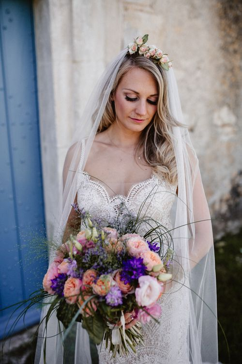 Bride In Watters With Pink & Plum Toned Wedding Bouquet