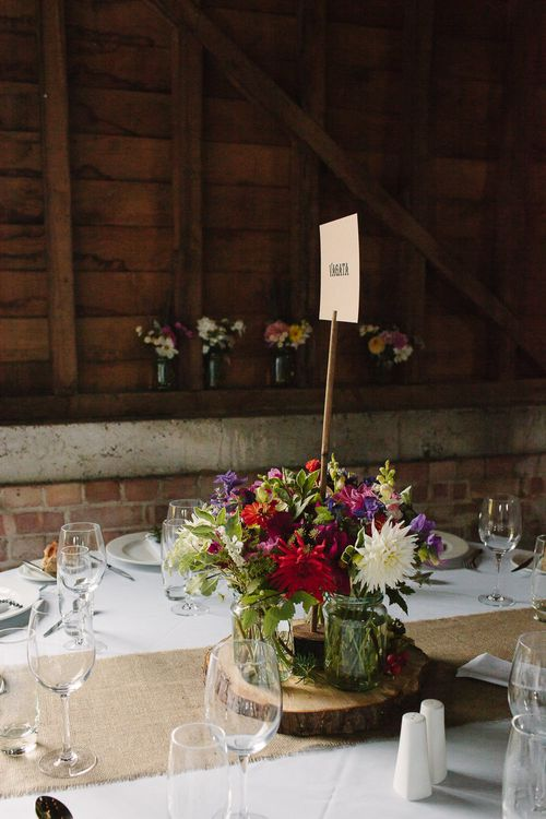 Rustic Tree Slice & Flowers in Jars Centrepiece
