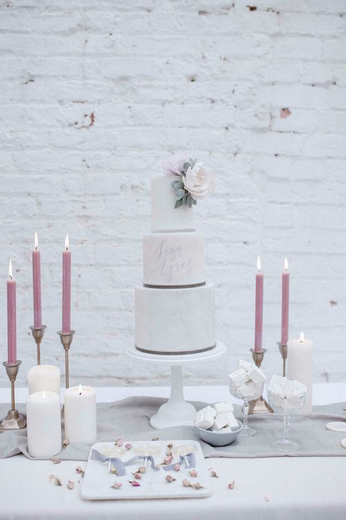 White Wedding Cake With Pale Pink Icing