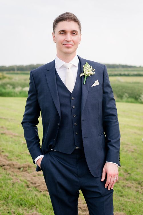 Groom in Navy Reiss Suit   Turner & Moss Photography