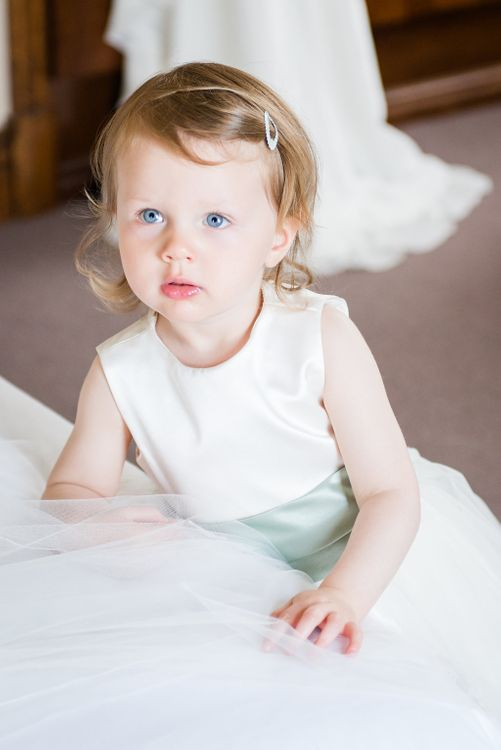 Flower Girl in Dessy Dress with Pale Green Sash   Turner & Moss Photography