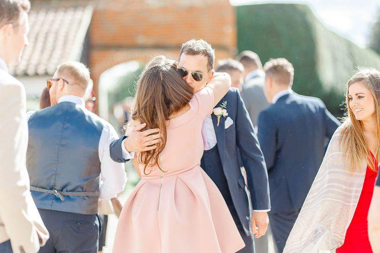 Hugs | Elegant Pastel Wedding at Gaynes Park, Essex | White Stag Wedding Photography | At Motion Film