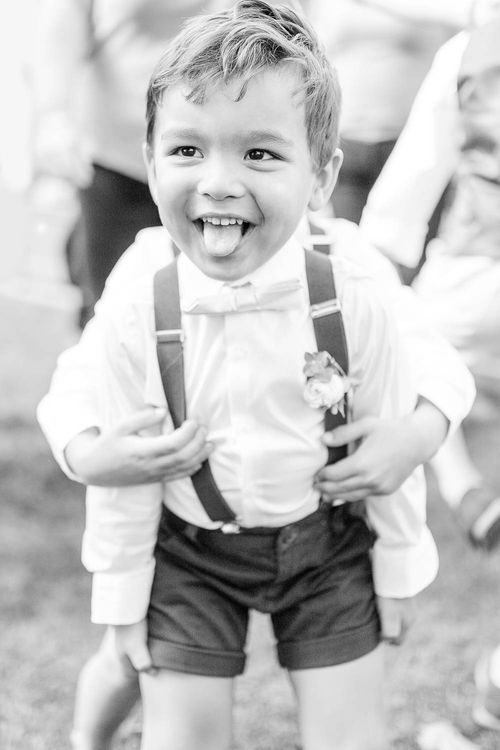 Page Boy in Bow Tie & Braces | Elegant Pastel Wedding at Gaynes Park, Essex | White Stag Wedding Photography | At Motion Film