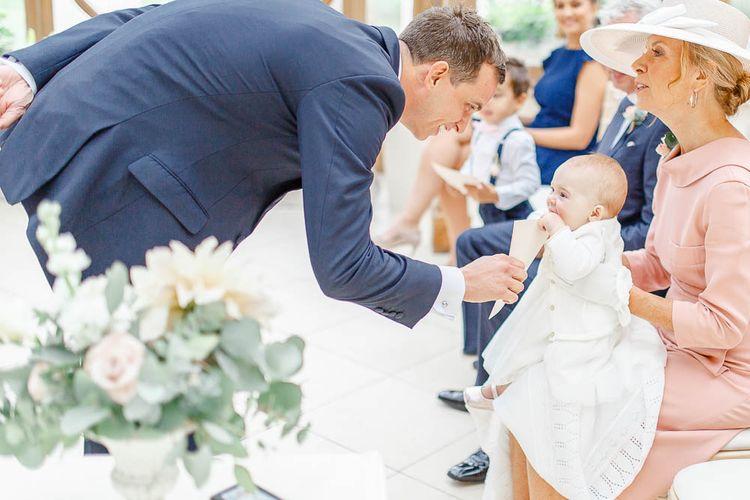 Groom in Navy Suit ^ Baby | Elegant Pastel Wedding at Gaynes Park, Essex | White Stag Wedding Photography | At Motion Film