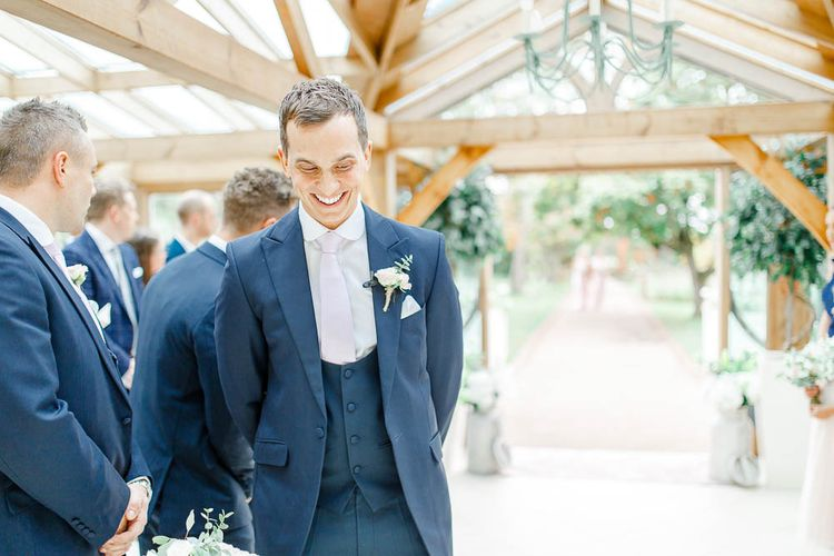 Groom at the Altar in Next Blue Suit at the Altar | Elegant Pastel Wedding at Gaynes Park, Essex | White Stag Wedding Photography | At Motion Film