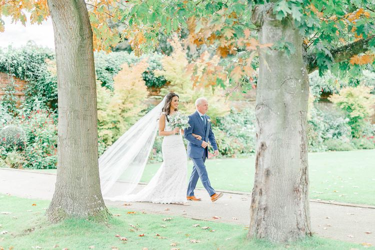 Bridal Entrance in Lace Gown from Blackburn Bridal | Elegant Pastel Wedding at Gaynes Park, Essex | White Stag Wedding Photography | At Motion Film