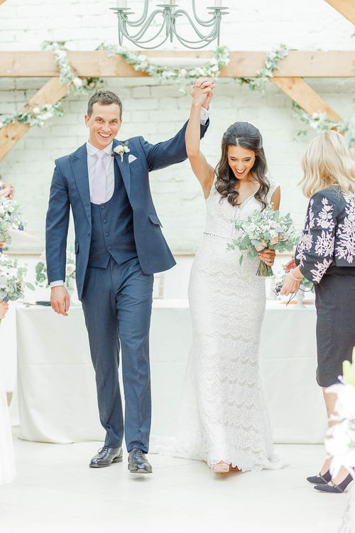Wedding Ceremony | Bride in Lace Gown from Blackburn Bridal | Groom in Navy Three-piece Suit | Elegant Pastel Wedding at Gaynes Park, Essex | White Stag Wedding Photography | At Motion Film