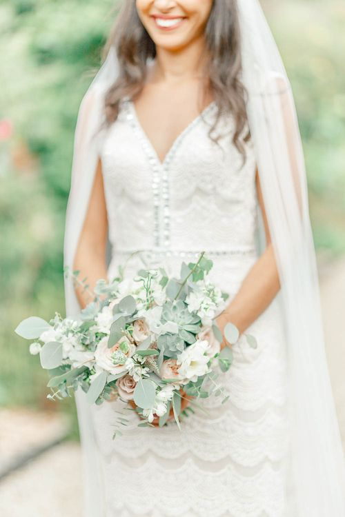 Bride in Lace Gown from Blackburn Bridal | Delicate Bouquet | Elegant Pastel Wedding at Gaynes Park, Essex | White Stag Wedding Photography | At Motion Film