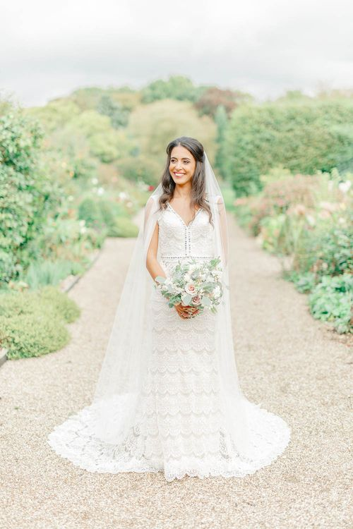 Bride in Lace Gown from Blackburn Bridal | Elegant Pastel Wedding at Gaynes Park, Essex | White Stag Wedding Photography | At Motion Film