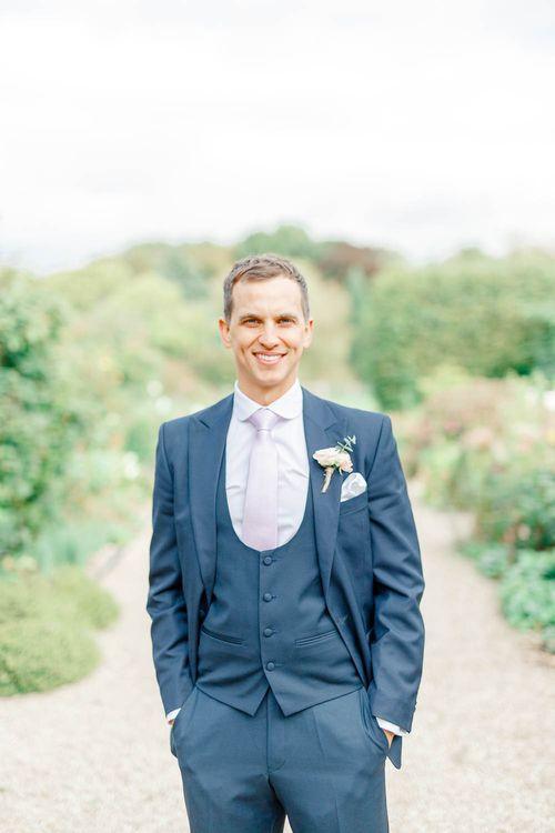 Groom in Navy Three-piece Suit | Elegant Pastel Wedding at Gaynes Park, Essex | White Stag Wedding Photography | At Motion Film