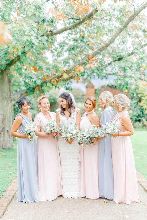 Bridesmaids in Grey & Pink Multiway Dresses | Elegant Pastel Wedding at Gaynes Park, Essex | White Stag Wedding Photography | At Motion Film
