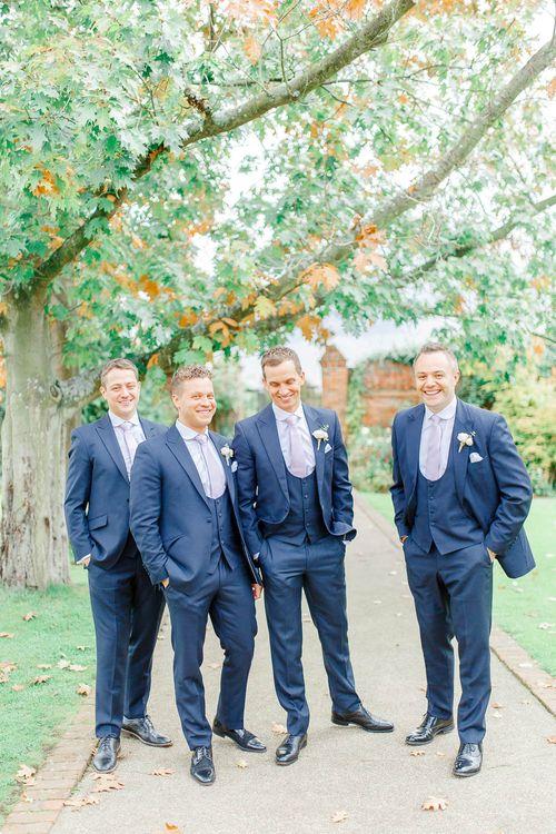 Groomsmen in Navy Three-piece Suits | Elegant Pastel Wedding at Gaynes Park, Essex | White Stag Wedding Photography | At Motion Film