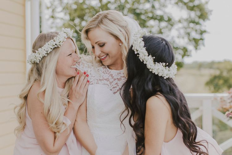 Bride in Lace By Malina Bridal Gown & Bridesmaids in Baby Pink ASOS Dresses