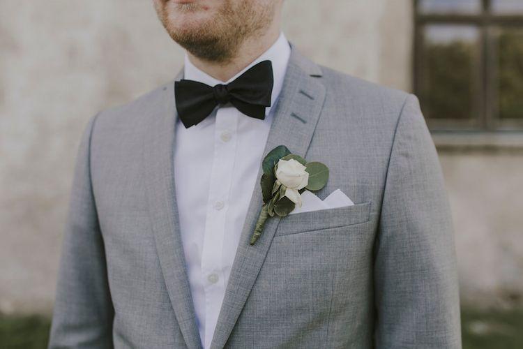 Groom in Grey Tiger of Sweden Suit