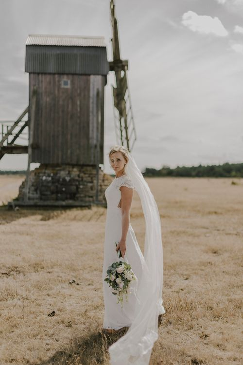Bride in By Malina Bridal Gown