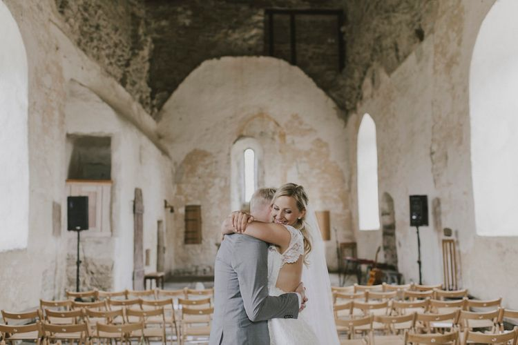 Bride in By Malina Bridal Gown & Groom in Grey Tiger of Sweden Suit