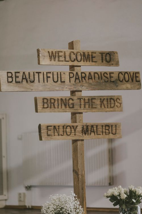 Rustic Wooden Picket Fence Direction Sign
