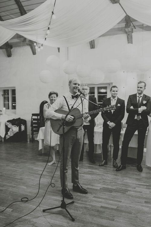 Groom Singing to his Bride