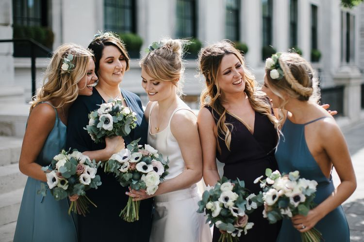 Delphine Manivet Bride With Bridesmaids In Reformation & Stylish London Wedding At Town Hall Hotel With Groom In Light Green & Images By Chris Barber