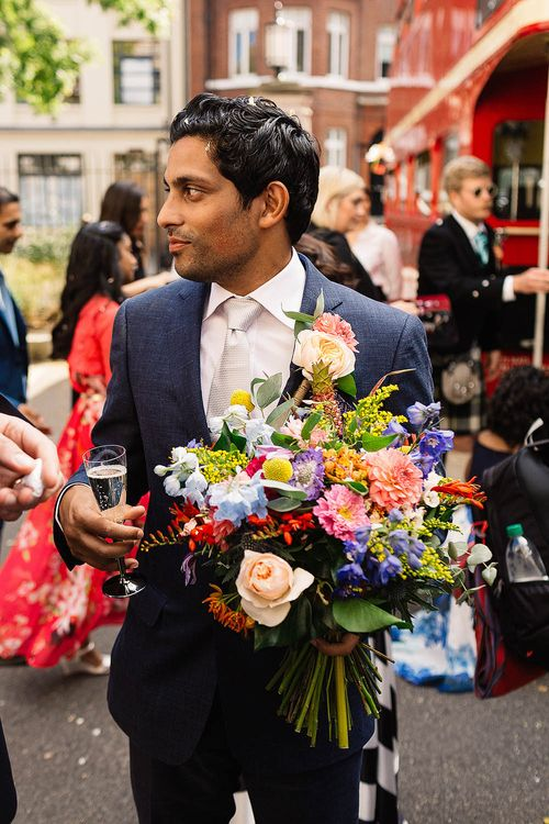 Groom in Banana Republic Suit & Bright Bridal Bouquet