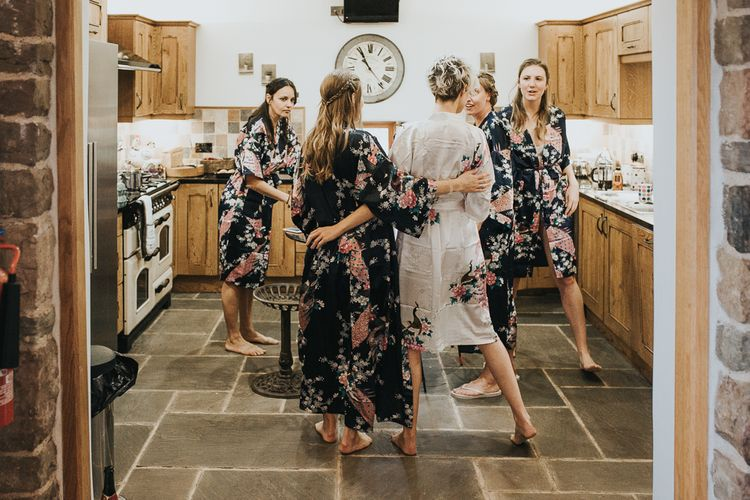 Bridesmaids In Floral Robes On Morning Of Wedding