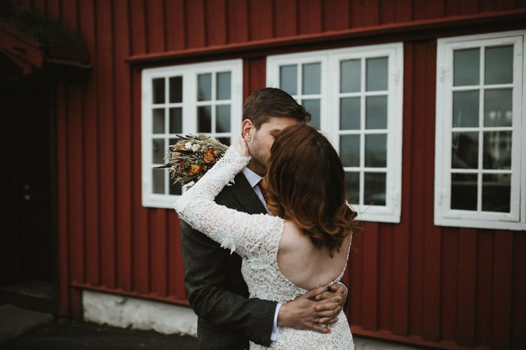First Look   Bride in Lace BHLDN Dress   Groom in Tweed Jacket   A Rainy Elopement on the Faroe Islands, North of Scotland   James Frost Photography