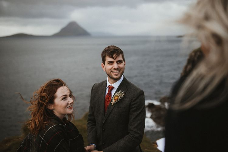 Wedding Ceremony   Bride in Lace BHLDN Dress   Groom in Tweed Jacket   A Rainy Elopement on the Faroe Islands, North of Scotland   James Frost Photography