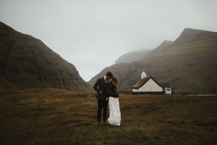 Bride in Lace BHLDN Dress   Groom in Tweed Jacket   A Rainy Elopement on the Faroe Islands, North of Scotland   James Frost Photography