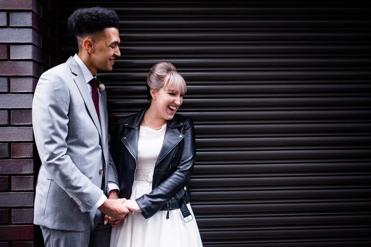 Bride in Bespoke Tea Length Wedding Dress | Groom in Grey Jaeger Suit | 60s Inspired London Pub Wedding | The Peasant | Babb Photo