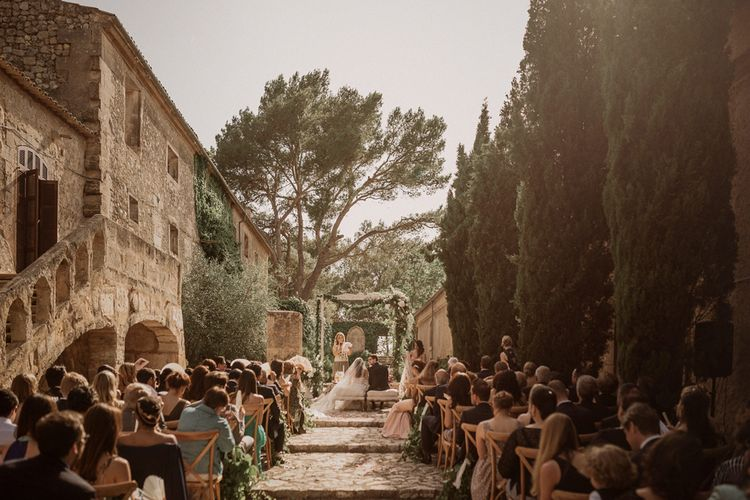 Outdoor Wedding Ceremony | Multicultural Wedding at Els Calderers in Mallorca, Spain | Pablo Laguia Photography | HUMá06 Film