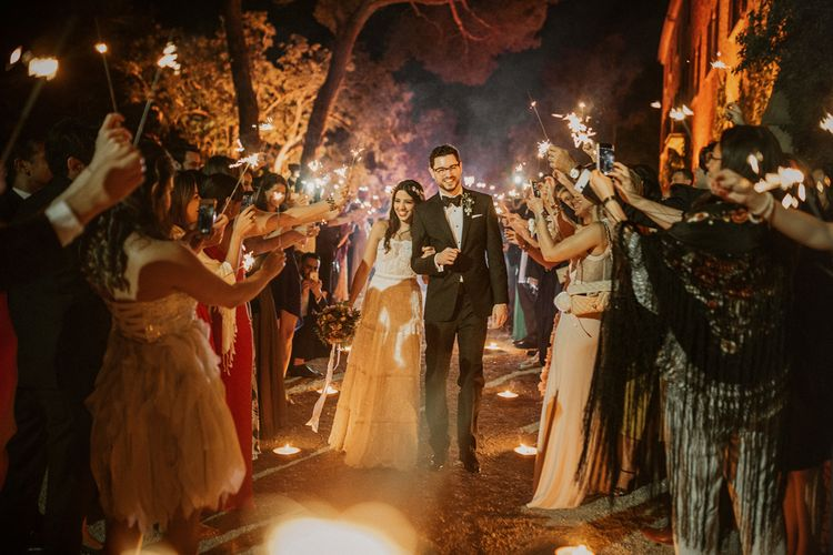 Sparkler Exit | Bride in Lihi Hod Bridal Gown | Groom in Richard James Savile Row Suit | Multicultural Wedding at Els Calderers in Mallorca, Spain | Pablo Laguia Photography | HUMá06 Film