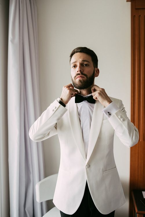 Groom in Tailor Made Tom Black Suit   Stylish Outdoor Wedding at Masia Casa del Mar in Barcelona, Spain   Sara Lobla Photography   Made in Video Film