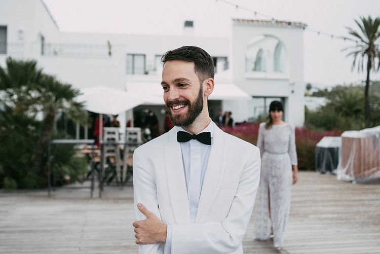 First Look   Groom in Tailor Made Tom Black Suit   Bride in Embellished Ze García Bridal Gown with Front Split   Stylish Outdoor Wedding at Masia Casa del Mar in Barcelona, Spain   Sara Lobla Photography   Made in Video Film