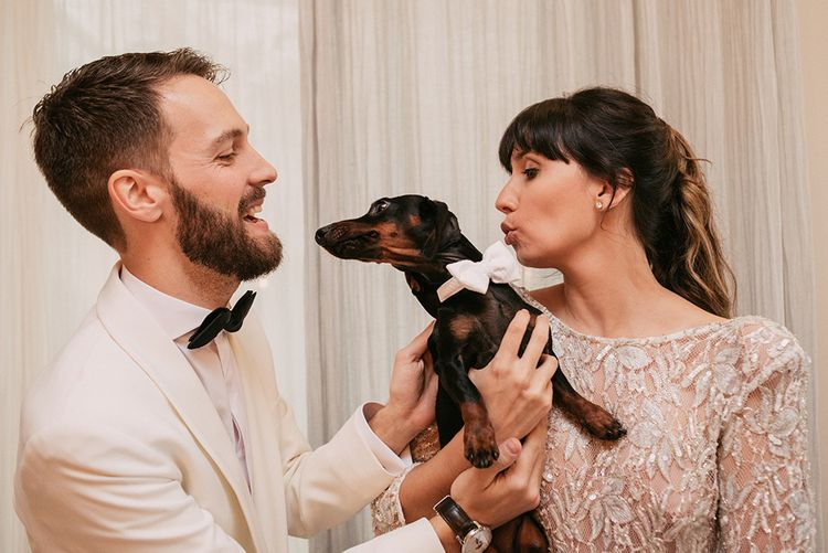 Pet Dachshund   Groom in Tailor Made Tom Black Suit   Bride in Embellished Ze García Bridal Gown with Front Split   Stylish Outdoor Wedding at Masia Casa del Mar in Barcelona, Spain   Sara Lobla Photography   Made in Video Film