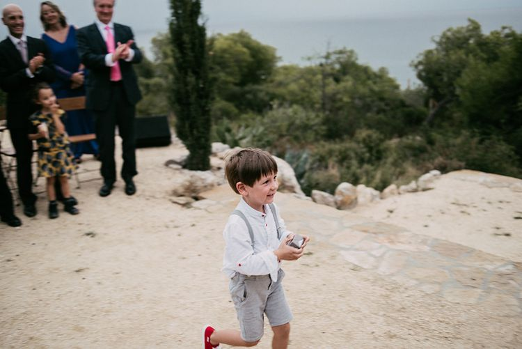Wedding Ceremony   Page Boy   Ring Bearer   Stylish Outdoor Wedding at Masia Casa del Mar in Barcelona, Spain   Sara Lobla Photography   Made in Video Film