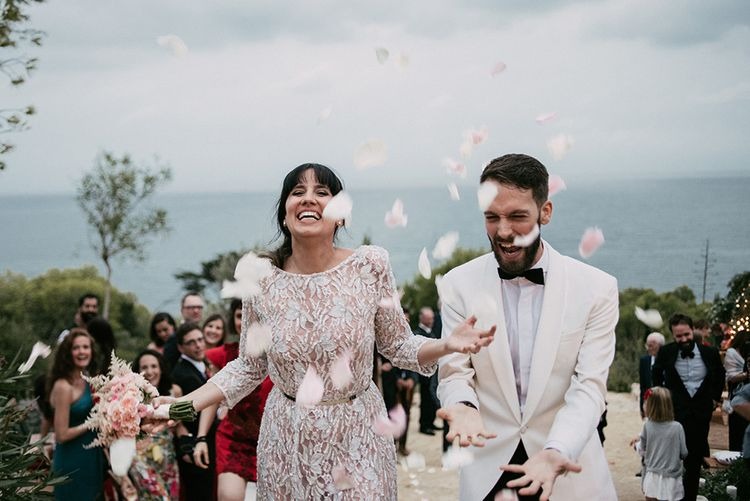 Confetti Exit   Bride in Embellished Ze García Bridal Gown with Front Split   Groom in Tailor Made Tom Black Suit   Stylish Outdoor Wedding at Masia Casa del Mar in Barcelona, Spain   Sara Lobla Photography   Made in Video Film
