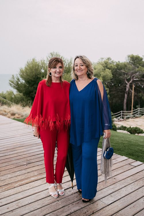 Stylish Wedding Guests in Red & Navy Jumpsuits   Stylish Outdoor Wedding at Masia Casa del Mar in Barcelona, Spain   Sara Lobla Photography   Made in Video Film