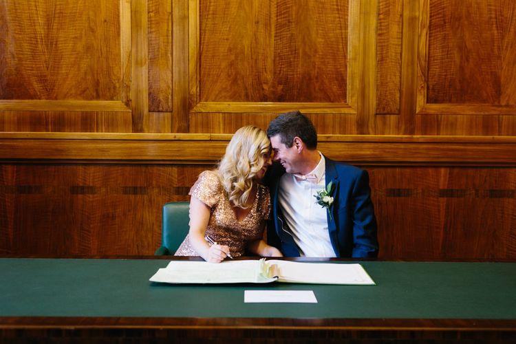 Bride & Groom Signing the Register