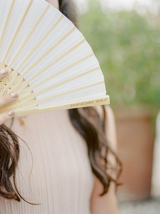 Personalised Fan Wedding Favour | Elegant Family Destination Wedding at Malcesine in Italy, Planned by Lake Garda Weddings | Georgina Harrison Photography