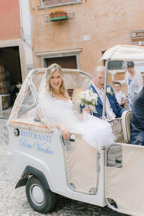 Bridal Entrance on a Tuc Tuc | Elegant Family Destination Wedding at Malcesine in Italy, Planned by Lake Garda Weddings | Georgina Harrison Photography