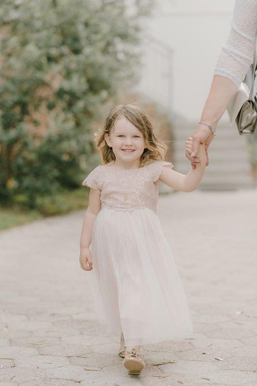 Flower Girl in Monsoon Dress | Elegant Family Destination Wedding at Malcesine in Italy, Planned by Lake Garda Weddings | Georgina Harrison Photography
