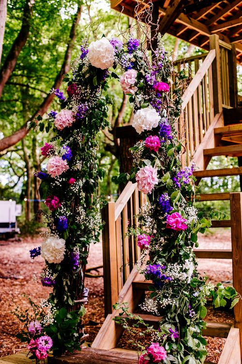 Floral Arch   Brightly Coloured Woodland Wedding   Epic Love Story Photography