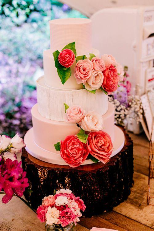 Wedding Cake on Tree Stump Cake Stand   Brightly Coloured Woodland Wedding   Epic Love Story Photography