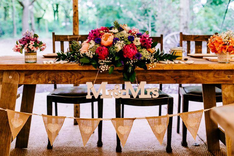 Chair Backs & Floral Arrangement Decor   Woodland Wedding   Epic Love Story Photography