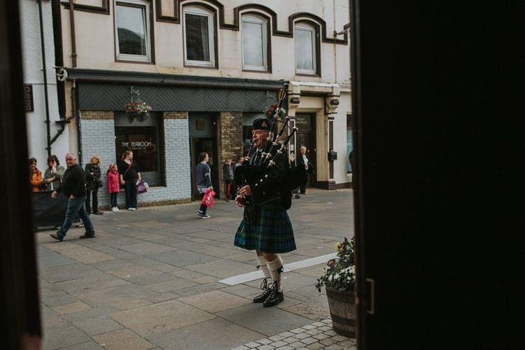 Traditional Scottish Bagpiper in Kilt