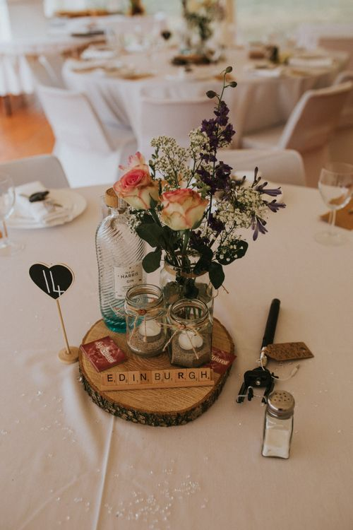 Tree Slice Centrepiece with Flowers in Bottles