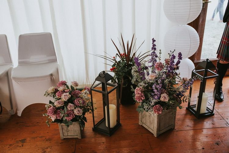 Hurricane Lamps & Wooden Crates Full of Wild Flowers Rustic Wedding Decor